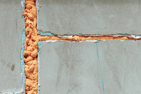 Polyurethane foam insulation in wall, construction industry background Banco de Imagens