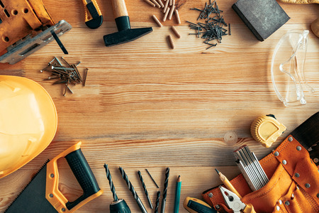 Handyman professional DIY project workplace tabletop with various tools and mock up copy space