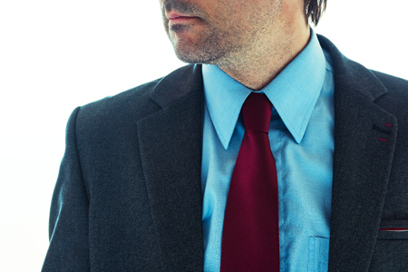 Businessman in elegant suit, well dressed male business person close up 免版税图像