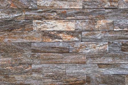 Stone brick tile as background, modern italian style wall made of tiled stone blocks