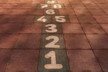 Hopscotch game on outdoor playground for children in diminishing perspective