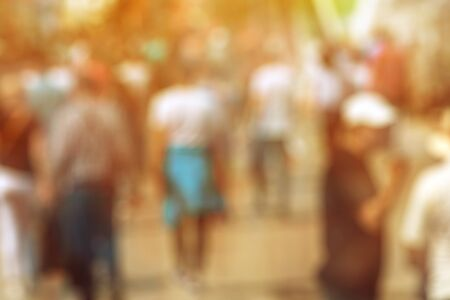 Blur crowd on street in summer, large group people out of focus