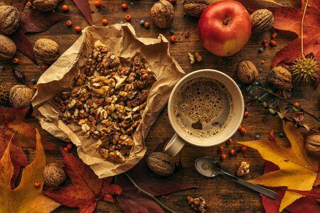 Coffee, apple and walnut on table - top view of autumn season arrangement 免版税图像