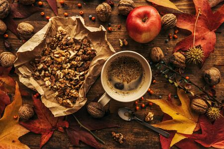 Enjoying fruits of autumn - apple, coffee and walnut on table for Thanksgiving day concept top view
