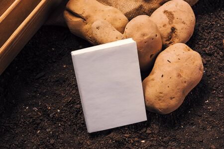 Growing organicpotato book cover mook up with harvested tubers on the ground 写真素材