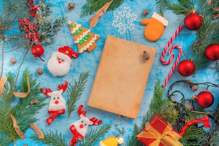 Christmas decoration and vintage fairy tale book mock up on the table, flat lay top view