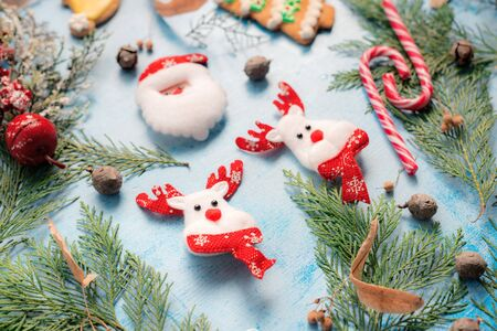 Christmas decoration, raindeer and Santa Claus on wooden table