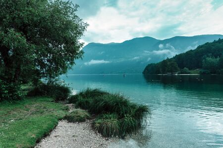 Cold summer afternoon at Lake Bohinj, Slovenia with overcast clouds Zdjęcie Seryjne