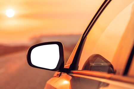 Mock up side view mirror of car on road in autumn sunset for travel, car insurance or roadside assistance concept, selective focus Zdjęcie Seryjne