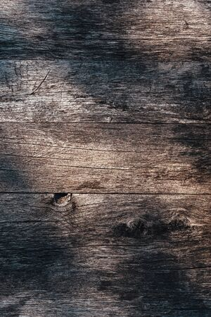 Grunge worn wooden surface texture with shadow pattern from above