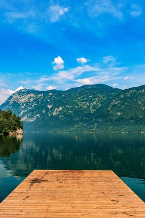 Wooden pier at Lake Bohinj in summer morning, beautiful landscape of Slovenia travel destination