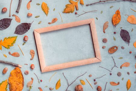Autumn decoration and blank picture frame for fine art, flat lay top view