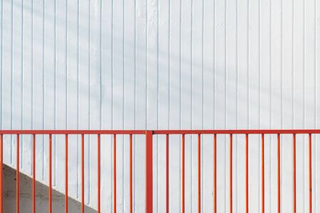Red steel bar fence and white stripped wall, abstract urban minimal background Stock fotó