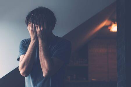 Male midlife crisis depression stage concept, depressed man crying in loft apartment Reklamní fotografie