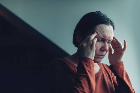 Woman with severe migraine headache, selective focus