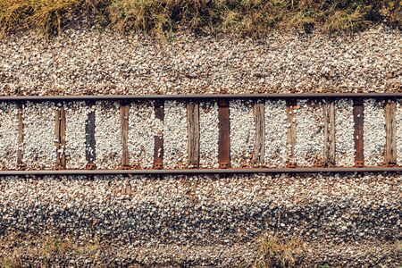Old railroad track through countryside in autumn, aerial view from drone pov Banco de Imagens