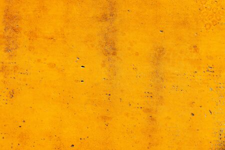 Yellow painted concrete flooring surface as background, top view texture
