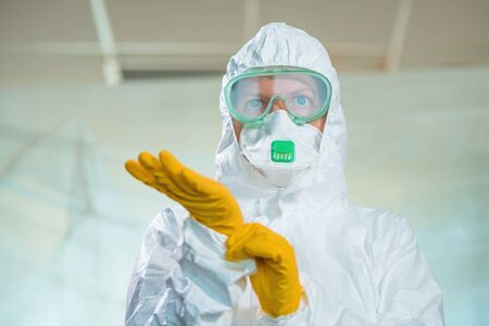 Portrait of female epidemiologist in virus quarantine, tight close up headshot of medical professional in protective clothing overalls Zdjęcie Seryjne