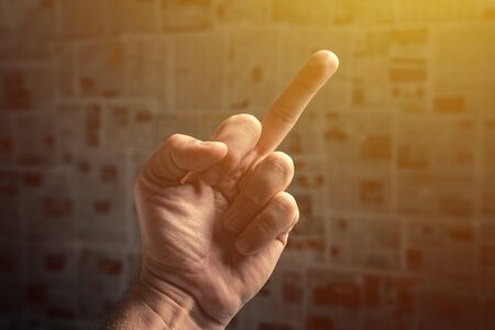 Middle finger to fake news, angry enraged man making obscene hand gesture