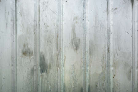 Corrugated steel metal background, weathered metallic surface pattern