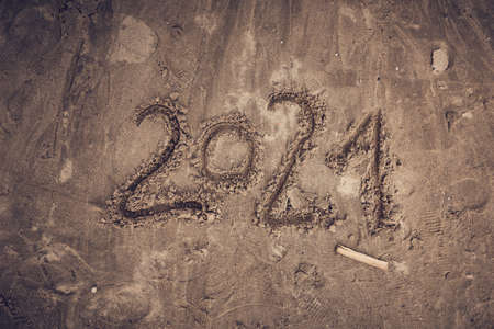 2021 number written in beach sand, top view