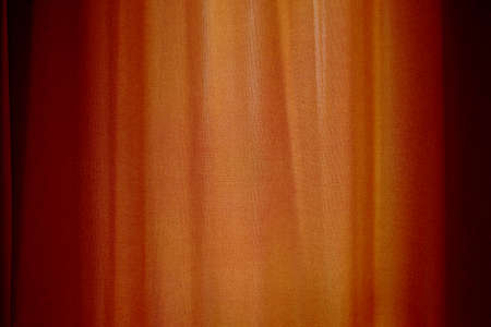 Behind closed curtains, wrinkled window blinds as background