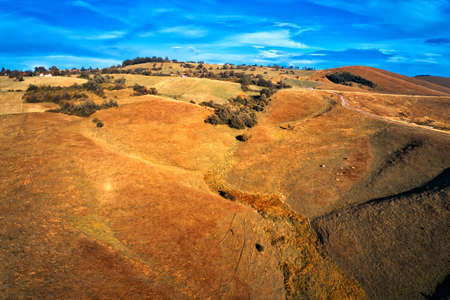 Aerial view of beautiful Zlatibor landscape in autumn sunset from drone pov. Barren hills and slopes of south-west Serbia.