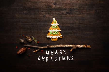 Gingerbread Christmas tree top view flat lay on dark wooden background