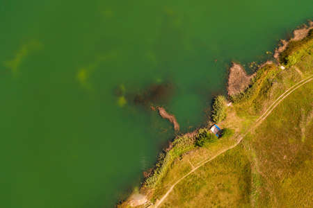 Aerial view of lake and embankment from drone pov, top view image as abstract natural background Banque d'images