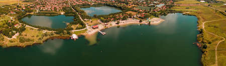 Panoramic aerial view of Lake Peskara in Zrenjanin, Serbia in sunny summer afternoon from drone pov Banque d'images