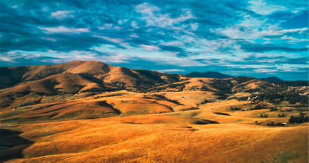 Barren landscape of Zlatibor mountain hill slopes in autumn sunset, aerial view from drone pov