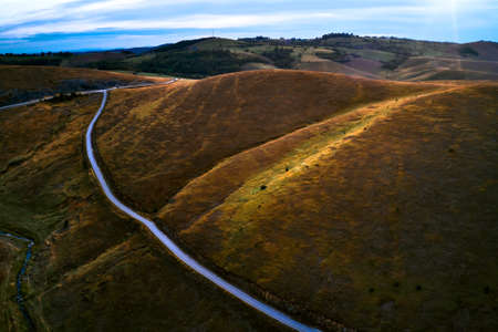 Aerial view of beautiful Zlatibor region landscape with asphalt road passing through from drone pov. Zlatibor is mountain located in south-west Serbia Banque d'images