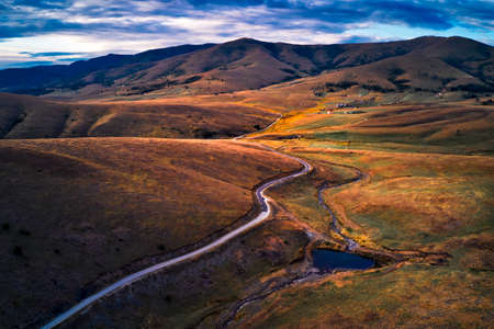 Aerial view of beautiful Zlatibor region landscape with asphalt road passing through from drone pov. Zlatibor is mountain located in south-west Serbia 版權商用圖片