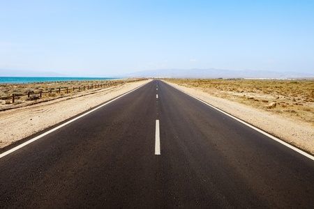 high desert: Straight road in desertic seascape. Andalusia.