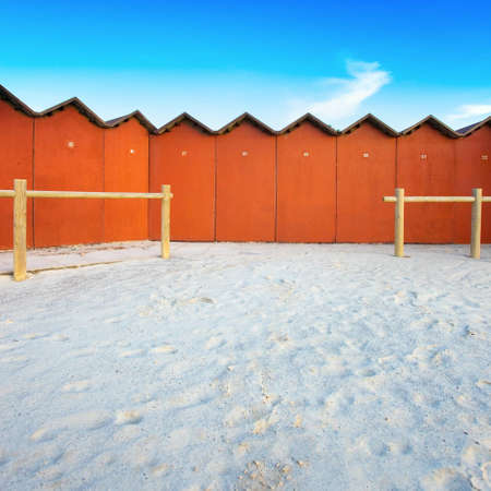 A series of bathing huts on a white beach in Tuscany  Bathing huts are also known as a beach cabins or bathing boxes  photo