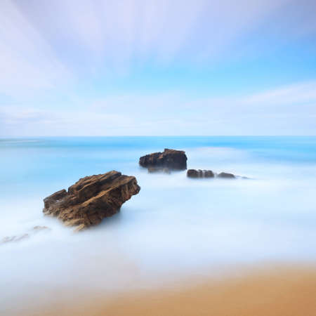 A long exposure photography with three rocks taken in winter on tuscan coast, Italy  Stock Photo - 12563791
