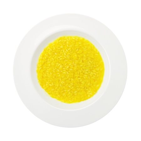 Traditional recipe saffron rice on a round plate isolated on white background photo