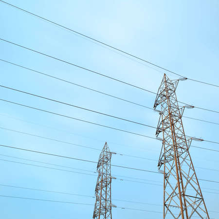 Two transmission towers, also known as electricity pylons with parallel wires. photo