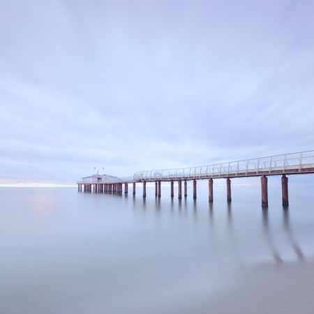 Pier soft water long exposure photography Lido di Camaiore, Versilia, Tuscany, Italy, Europe photo