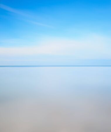 Horizon line, soft water sea and light cloudy blue sky. Long exposure photography over one minute. Stock Photo - 12996357