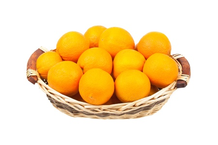 navel orange: Oranges in a food wicker basket isolated on white background