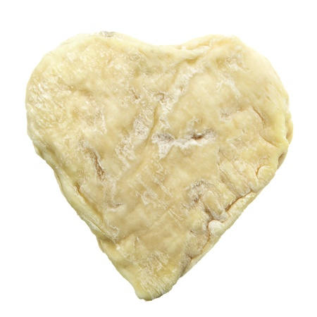 goat cheese: Heart shaped moldy traditional french goat cheese isolated on white background. It suits for love cheese wallpaper Stock Photo