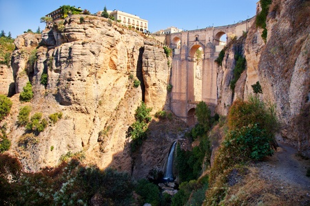 New bridge, falls and gorge in Ronda white village building on the rocks. Andalusia, Spain. photo