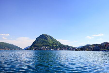 Lugano lake and mountains landscape  City, water, blue sky and mountains  Ticino, Swiss or Switzerland, Europe  photo