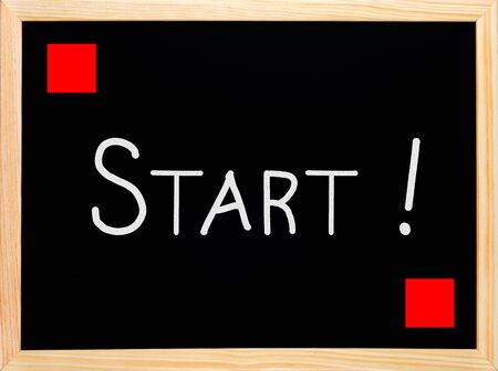 Start and red flag written on blackboard or chalkboard photo