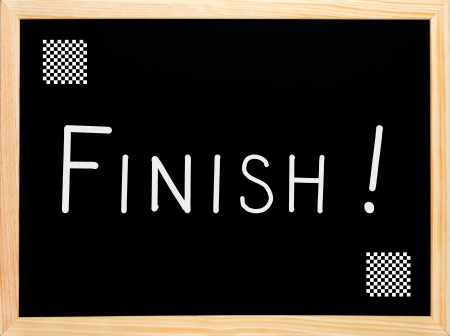 Finish and chess flag written on blackboard or chalkboard photo