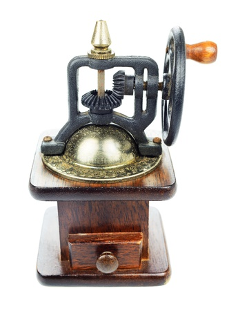 Manual vintage old grinder for coffee, pepper and other beans in wood and metal isolated on white background photo