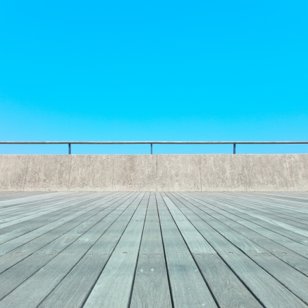 Balcony, Wooden plank floor, concrete fence and blue sky  Outdoor architecture, bottom perspective photo