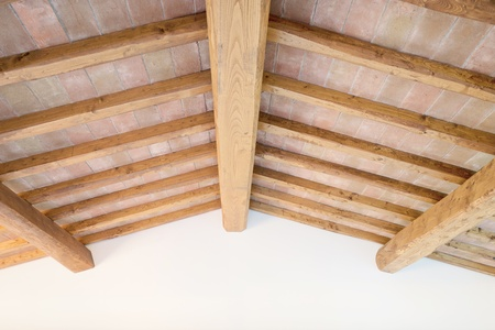 Tuscan traditional oak wood beam ceiling, red bricks pattern and wall on background  Classic italian rural interiors  photo