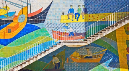 Azulejos colorful mosaic tiles on a wall and old exterior stairway in Lisbon street  Portugal  photo